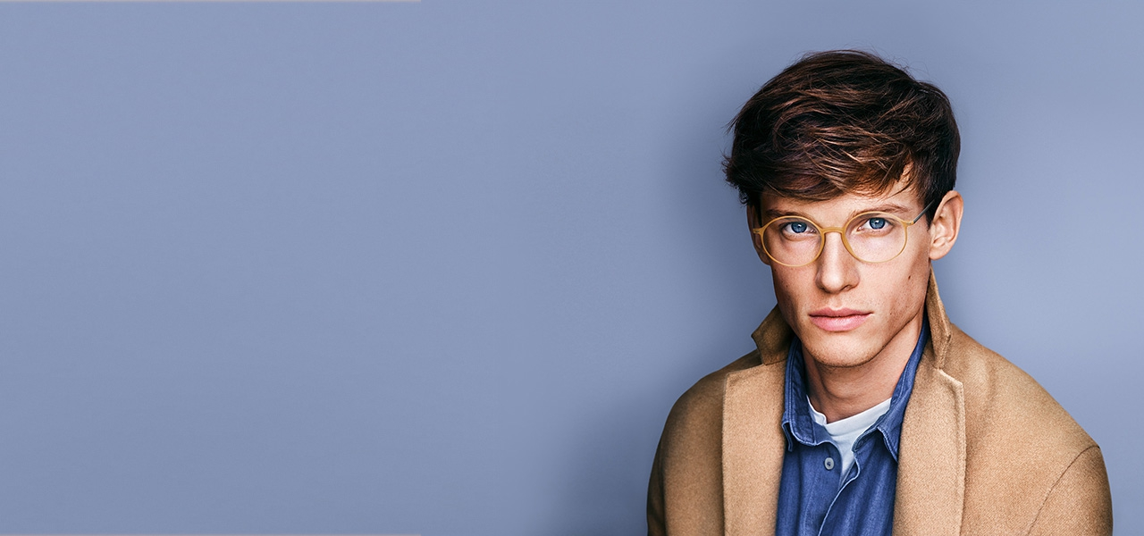 Male model wears Urban Lite with Vision Sensation™ lenses